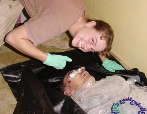 Sabrina Harman at Abu Ghraib with corpse